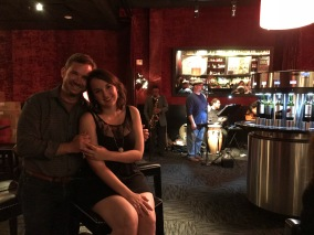 Dancing and sipping wine at a jazz bar.