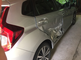 Hit and run car accident; we flipped around 360 degrees, wound up facing oncoming traffic, and lived!