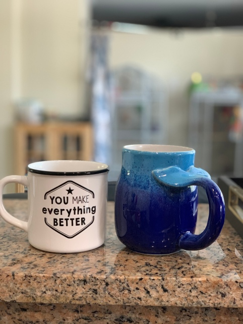 A mug he bought for me for mother's day, and the one he adores from our honeymoon.